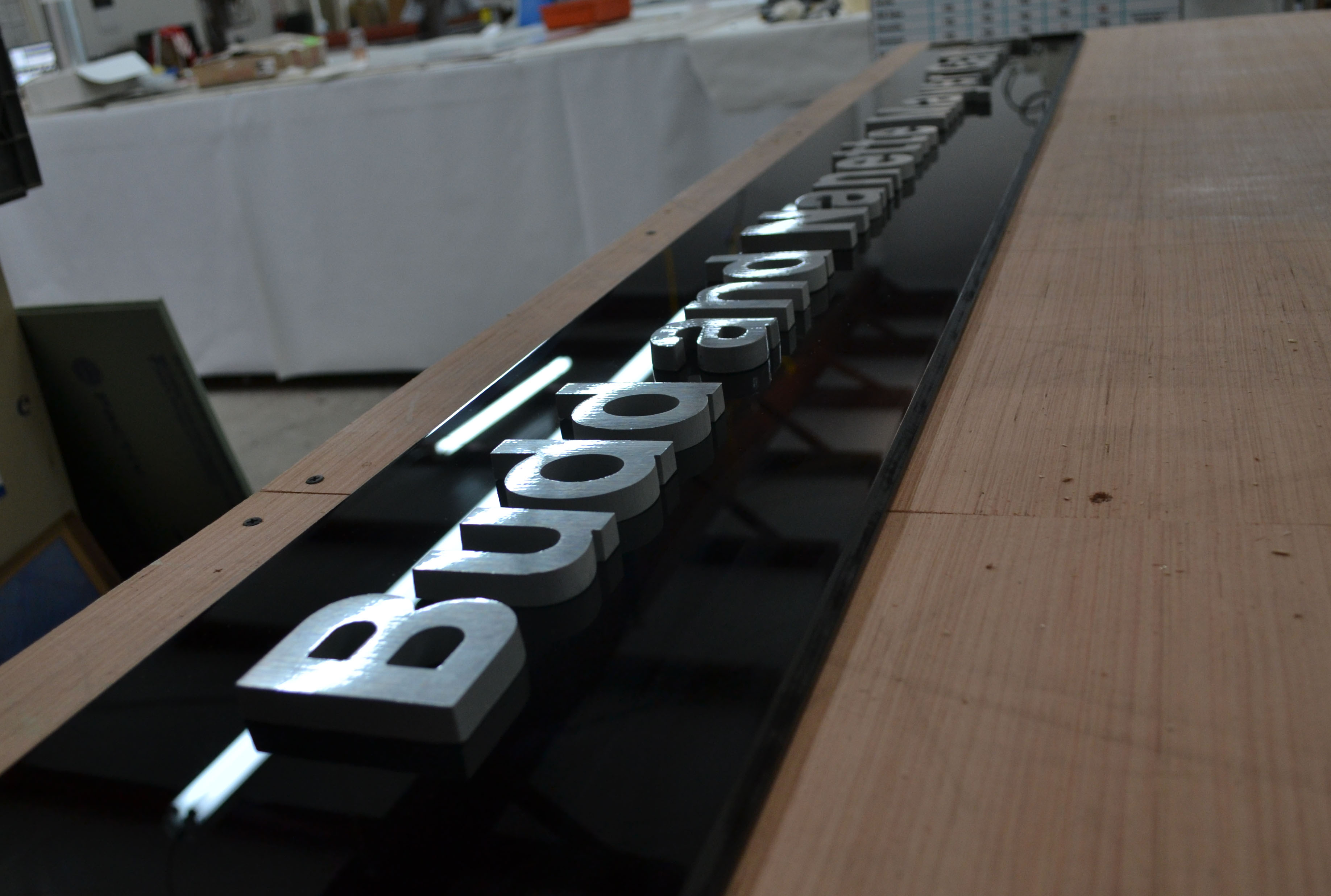 3D Metal Letters on Black Acrylic